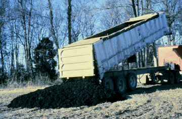 biosolids application starts with hauling the nutrients to a site, then spreading them